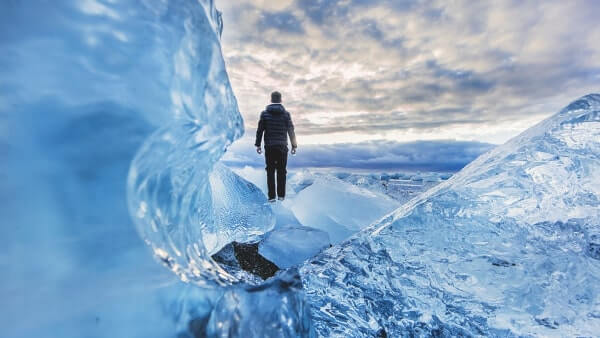 Man standing in an icy plain.